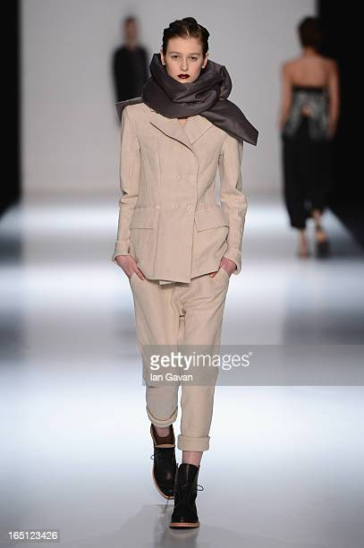 A model walks the runway at the Julia Nikolaeva show during MercedesBenz Fashion Week Russia Fall/Winter 2013/2014 at Manege on March 31 2013 in...