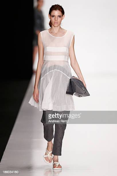 A model walks the runway at the Julia Nikolaeva show during MercedesBenz Fashion Week Russia S/S 2014 on October 27 2013 in Moscow Russia