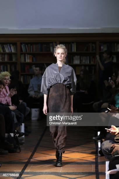 A model walks the runway at the Juliaandben show during MercedesBenz Fashion Week Autumn/Winter 2014/15 at Ehemalige Karl Marx Buchhandlung on...