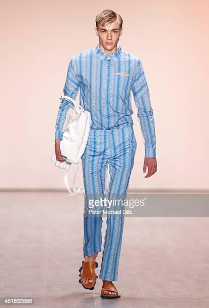A model walks the runway at the Julian Zigerli show during the MercedesBenz Fashion Week Spring/Summer 2015 at Erika Hess Eisstadion on July 8 2014...
