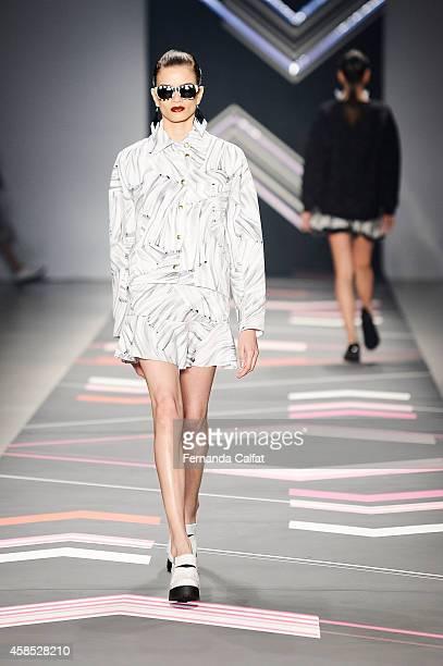 A model walks the runway at the Juliana Jabour fashion show during Sao Paulo Fashion Week Winter 2015 at Parque Candido Portinari on November 6 2014...