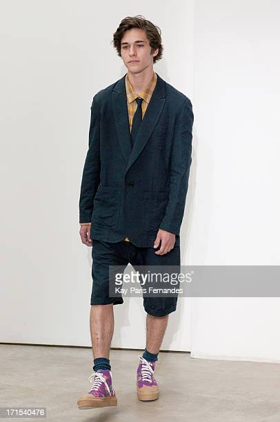 A model walks the runway at the Julien David Menswear Spring/Summer 2014 Show As Part Of The Paris Fashion Week on June 26 2013 in Paris France