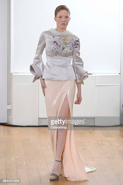 Model walks the runway at the Julien Fournie Spring Summer 2014 fashion show during Paris Haute Couture Fashion Week on January 21, 2014 in Paris,...