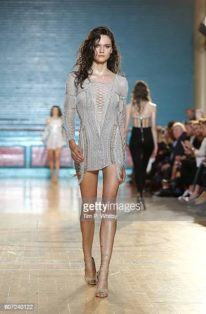 A model walks the runway at the Julien Macdonald show during London Fashion Week Spring/Summer collections 2017 at Seymore Leisure Centre on...