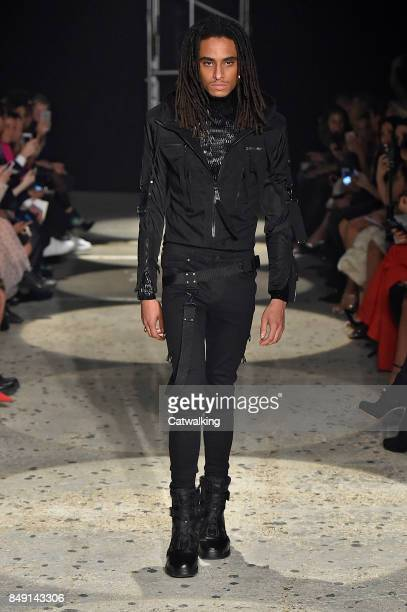 A model walks the runway at the Julien Macdonald Spring Summer 2018 fashion show during London Fashion Week on September 18 2017 in London United...
