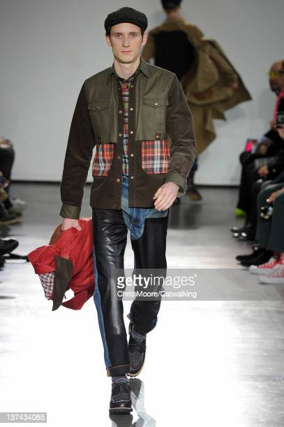 Model walks the runway at the Junya Watanabe Autumn Winter 2012 fashion show during Paris Menswear Fashion Week on January 20, 2012 in Paris, France.