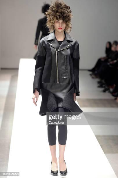 Model walks the runway at the Junya Watanabe Autumn Winter 2013 fashion show during Paris Fashion Week on March 2, 2013 in Paris, France.