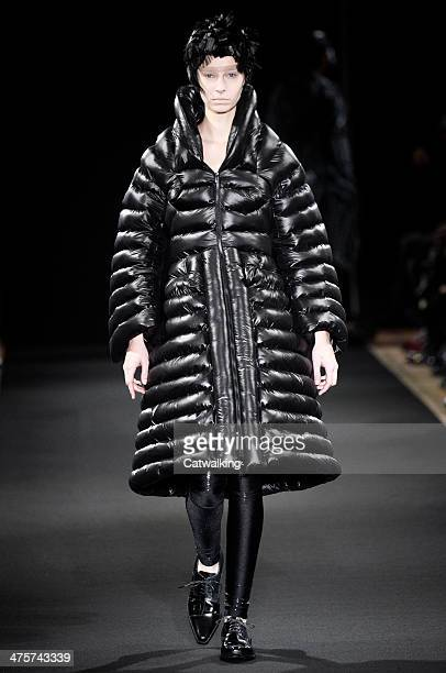 Model walks the runway at the Junya Watanabe Autumn Winter 2014 fashion show during Paris Fashion Week on March 1, 2014 in Paris, France.