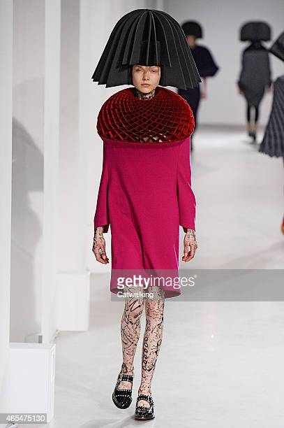 A model walks the runway at the Junya Watanabe Autumn Winter 2015 fashion show during Paris Fashion Week on March 7 2015 in Paris France