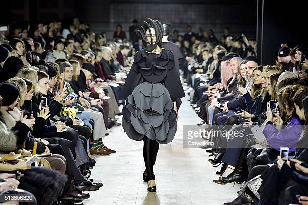 A model walks the runway at the Junya Watanabe Autumn Winter 2016 fashion show during Paris Fashion Week on March 5 2016 in Paris France