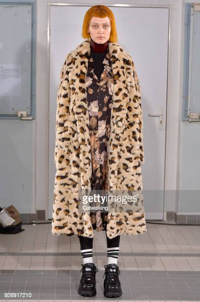 A model walks the runway at the Junya Watanabe Autumn Winter 2018 fashion show during Paris Fashion Week on March 3 2018 in Paris France