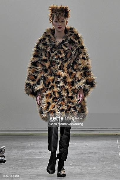 Model walks the runway at the Junya Watanabe fashion show during Paris Fashion Week on March 5, 2011 in Paris, France.