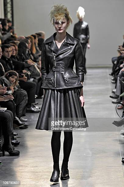 A model walks the runway at the Junya Watanabe fashion show during Paris Fashion Week on March 5 2011 in Paris France