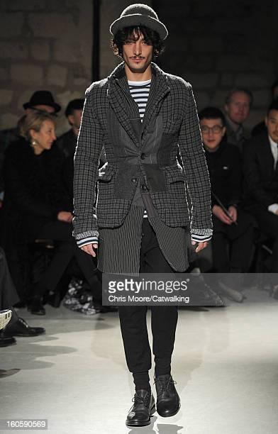 Model walks the runway at the Junya Watanabe Man Autumn Winter 2013 fashion show during Paris Menswear Fashion Week on January 18, 2013 in Paris,...