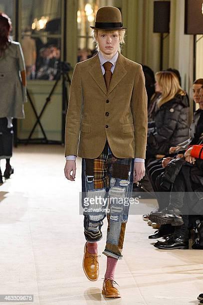 Model walks the runway at the Junya Watanabe Man Autumn Winter 2014 fashion show during Paris Menswear Fashion Week on January 17, 2014 in Paris,...