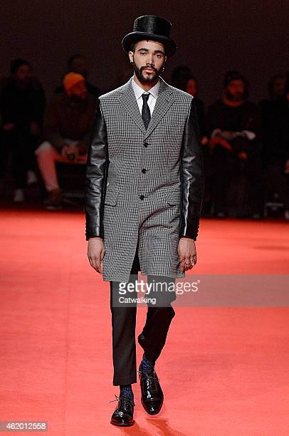 Model walks the runway at the Junya Watanabe Man Autumn Winter 2015 fashion show during Paris Menswear Fashion Week on January 23, 2015 in Paris,...