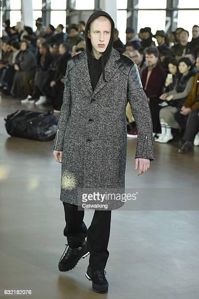 Model walks the runway at the Junya Watanabe Man Autumn Winter 2017 fashion show during Paris Menswear Fashion Week on January 20, 2017 in Paris,...