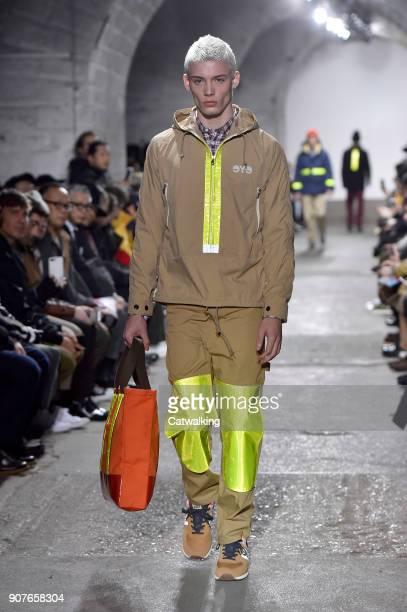 Model walks the runway at the Junya Watanabe Man Autumn Winter 2018 fashion show during Paris Menswear Fashion Week on January 19, 2018 in Paris,...