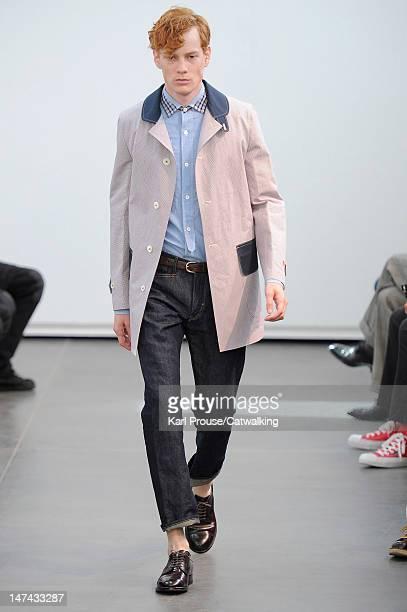 Model walks the runway at the Junya Watanabe Man Spring Summer 2013 fashion show during Paris Menswear Fashion Week on June 29, 2012 in Paris, France.