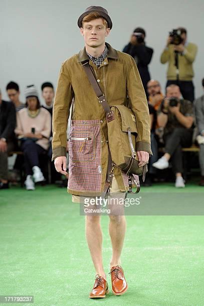 Model walks the runway at the Junya Watanabe Man Spring Summer 2014 fashion show during Paris Menswear Fashion Week on June 28, 2013 in Paris, France.