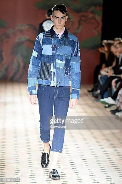 Model walks the runway at the Junya Watanabe Man Spring Summer 2015 fashion show during Paris Menswear Fashion Week on June 27, 2014 in Paris, France.