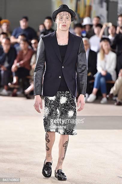 A model walks the runway at the Junya Watanabe Man Spring Summer 2017 fashion show during Paris Menswear Fashion Week on June 24 2016 in Paris France
