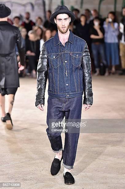Model walks the runway at the Junya Watanabe Man Spring Summer 2017 fashion show during Paris Menswear Fashion Week on June 24, 2016 in Paris, France.