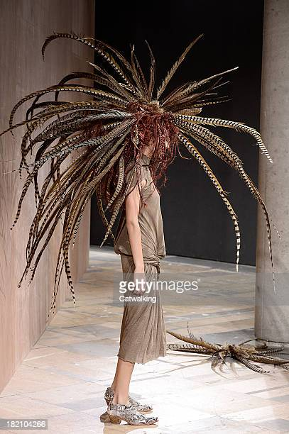 A model walks the runway at the Junya Watanabe Spring Summer 2014 fashion show during Paris Fashion Week on September 28 2013 in Paris France
