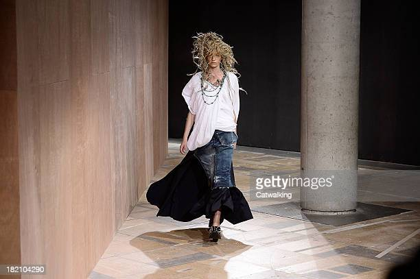 Model walks the runway at the Junya Watanabe Spring Summer 2014 fashion show during Paris Fashion Week on September 28, 2013 in Paris, France.