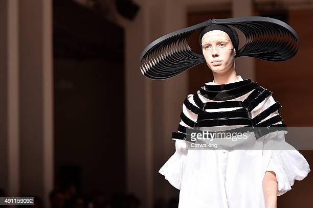 Model walks the runway at the Junya Watanabe Spring Summer 2016 fashion show during Paris Fashion Week on October 3, 2015 in Paris, France.