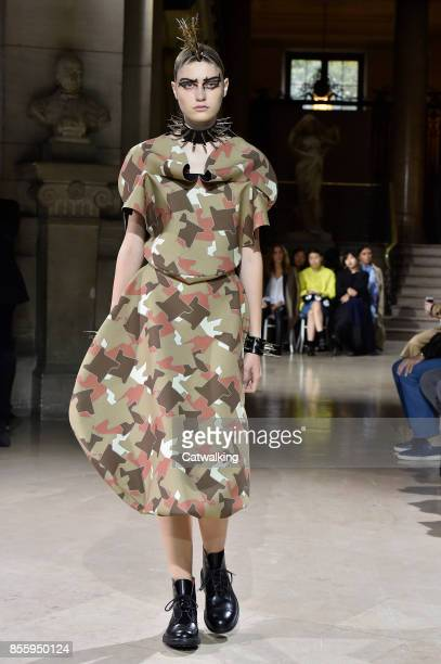 A model walks the runway at the Junya Watanabe Spring Summer 2018 fashion show during Paris Fashion Week on September 30 2017 in Paris France