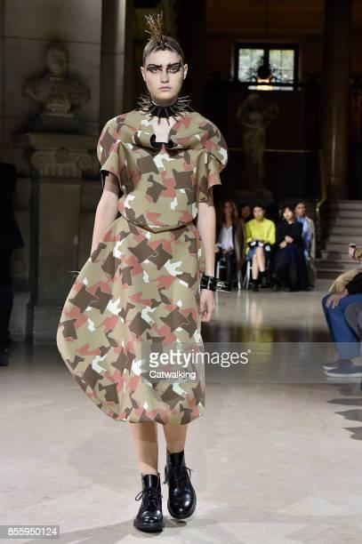 Model walks the runway at the Junya Watanabe Spring Summer 2018 fashion show during Paris Fashion Week on September 30, 2017 in Paris, France.