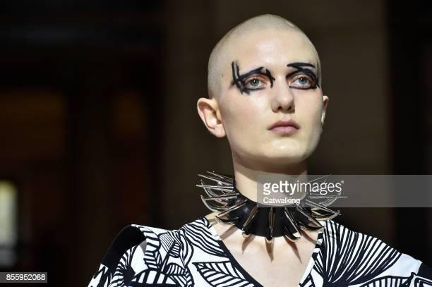 A model walks the runway at the Junya Watanabe Spring Summer 2018 fashion show during Paris Fashion Week on September 30 2017 in Paris France