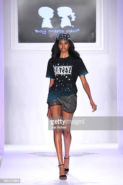 A model walks the runway at the Just Dance with Boy Meets girl by Stacy Igel fashion show during Style360 Spring 2014 at Metropolitan Pavilion on...