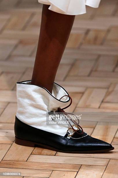 A model walks the runway at the JW Anderson Ready to Wear Spring/Summer 2019 fashion show during London Fashion Week September 2018 on September 15...