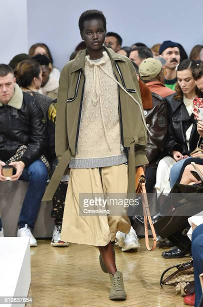 A model walks the runway at the JWAnderson Autumn Winter 2018 fashion show during London Fashion Week on February 17 2018 in London United Kingdom