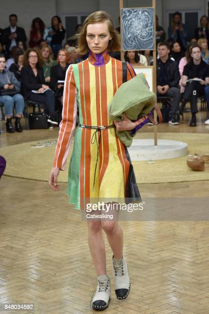 Model walks the runway at the J.W.Anderson Spring Summer 2018 fashion show during London Fashion Week on September 16, 2017 in London, United Kingdom.