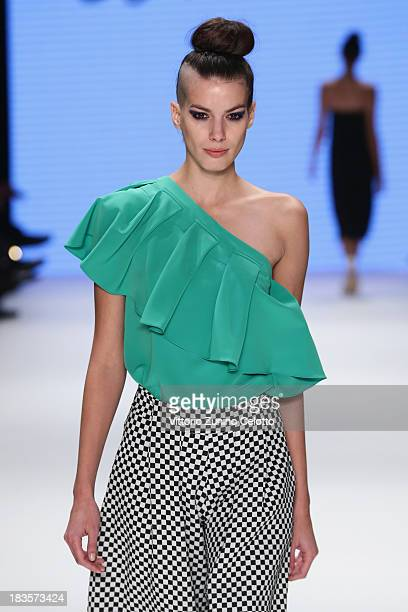 A model walks the runway at the Kaf Dan By Elaidi show during MercedesBenz Fashion Week Istanbul s/s 2014 presented by American Express on October 7...