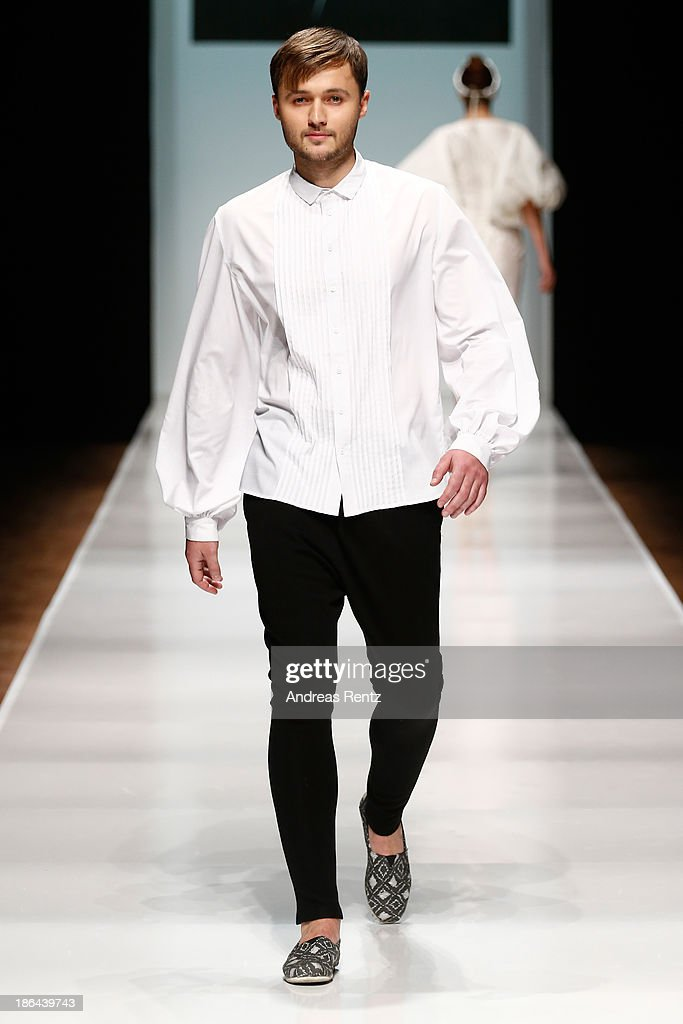 A model walks the runway at the Kamila Kurbani show during Mercedes-Benz Fashion Week Russia S/S 2014 on October 31, 2013 in Moscow, Russia.