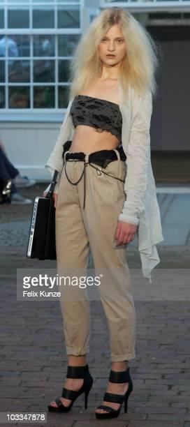 A model walks the runway at the Karen by Simonsen show at 'Copenhagen Fashion Week Spring / Summer 2011' on August 11 2010 in Copenhagen Denmark