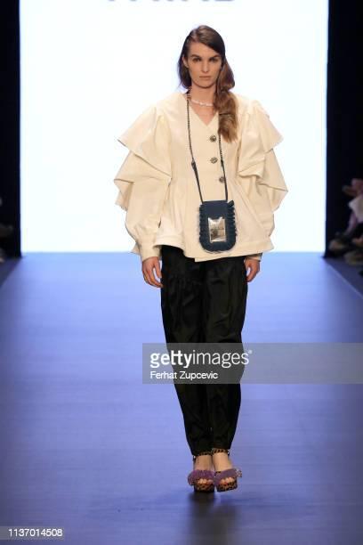 Model walks the runway at the Karma I Selen Akyuz-Third show during Mercedes-Benz Istanbul Fashion Week at the Zorlu Performance Hall on March 20,...