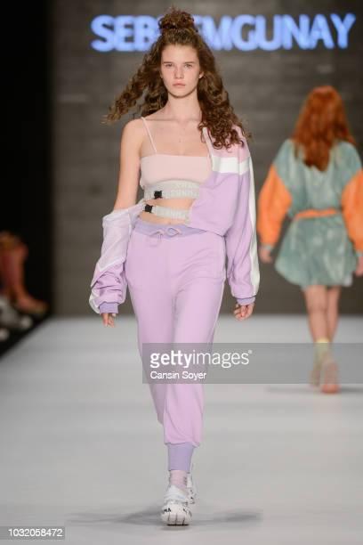A model walks the runway at the Karma II Third Sebnem Gunay show during the MercedesBenz Istanbul Fashion Week at Zorlu Performance Hall on September...