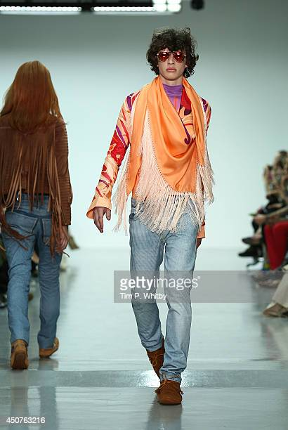 A model walks the runway at the Katie Eary show during the London Collections Men SS15 at Victoria House on June 17 2014 in London England