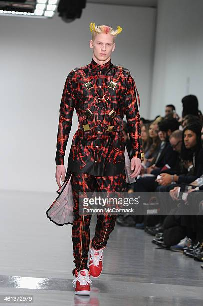 A model walks the runway at the Katie Eary show during The London Collections Men Autumn/Winter 2014 on January 8 2014 in London England