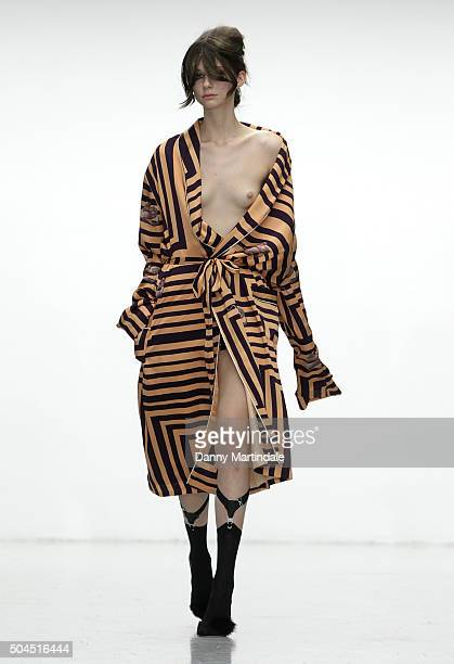 A model walks the runway at the Katie Eary show during The London Collections Men AW16 at Victoria House on January 11 2016 in London England