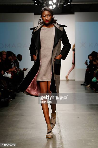 A model walks the runway at the Katty Xiomara show during Nolcha Fashion Week New York Fall/Winter 2014 presented by RUSK at Pier 59 on February 12...