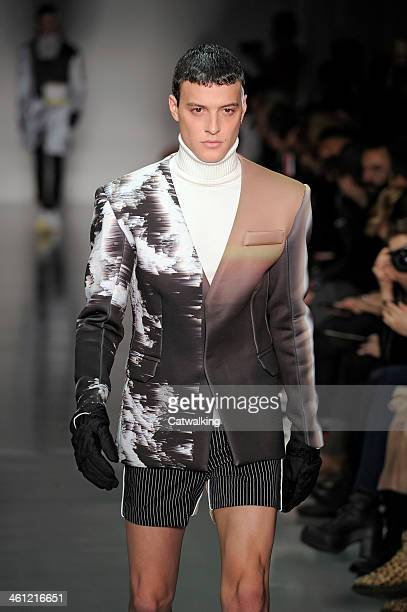A model walks the runway at the Kay Kwok Autumn Winter 2014 fashion show during London Menswear Fashion Week on January 7 2014 in London United...