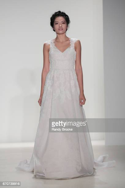 A model walks the runway at the Kelly Faetanini Runway show Spring 2018 season during New York Fashion Week Bridal April 2017 at EZ Studios on April...