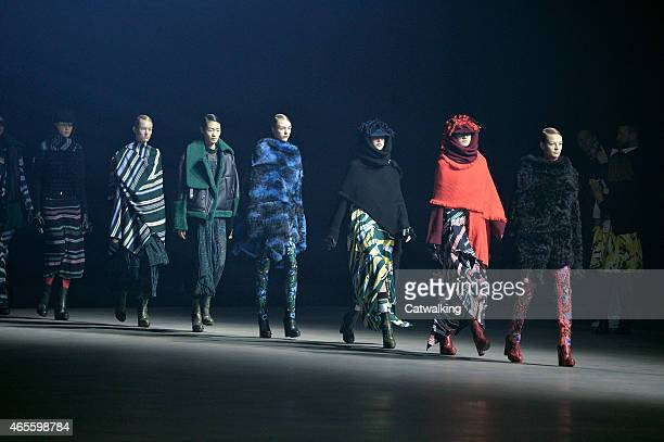 Model walks the runway at the Kenzo Autumn Winter 2015 fashion show during Paris Fashion Week on March 8, 2015 in Paris, France.
