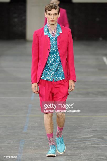 Model walks the runway at the Kenzo menswear fashion show during Paris Fashion Menswear Week on June 25, 2011 in Paris, France.